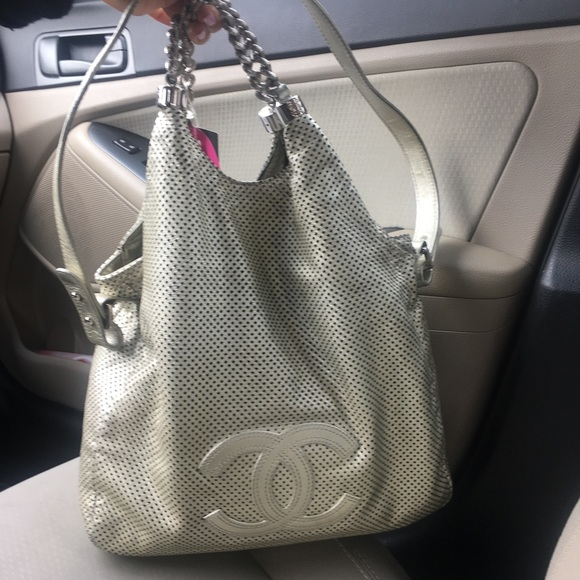 CHANEL Handbags - 💯AUTH CHANEL Silver Perforated Rodeo Drive Bag 6253c0a9be059
